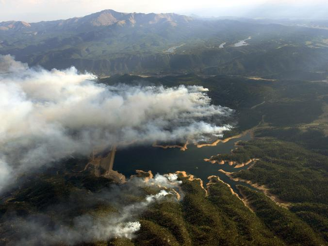 Smoke rises around Rampart Reservoir from Waldo Canyon Fire in this aerial photograph taken in Colorado Springs, Colorado, on June 27, 2012.