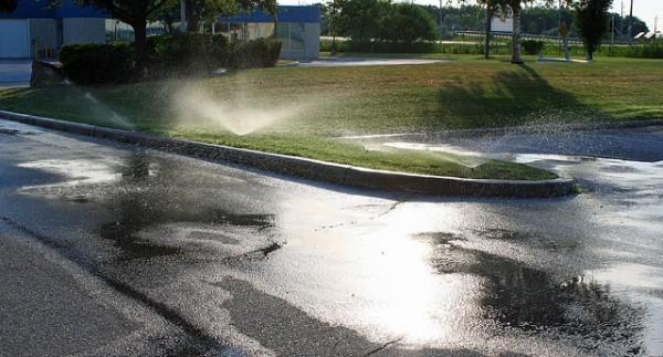sprinklers-watering-pavement